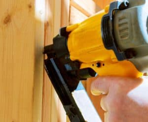 A framing nailer used to drive nails into wooden construction material