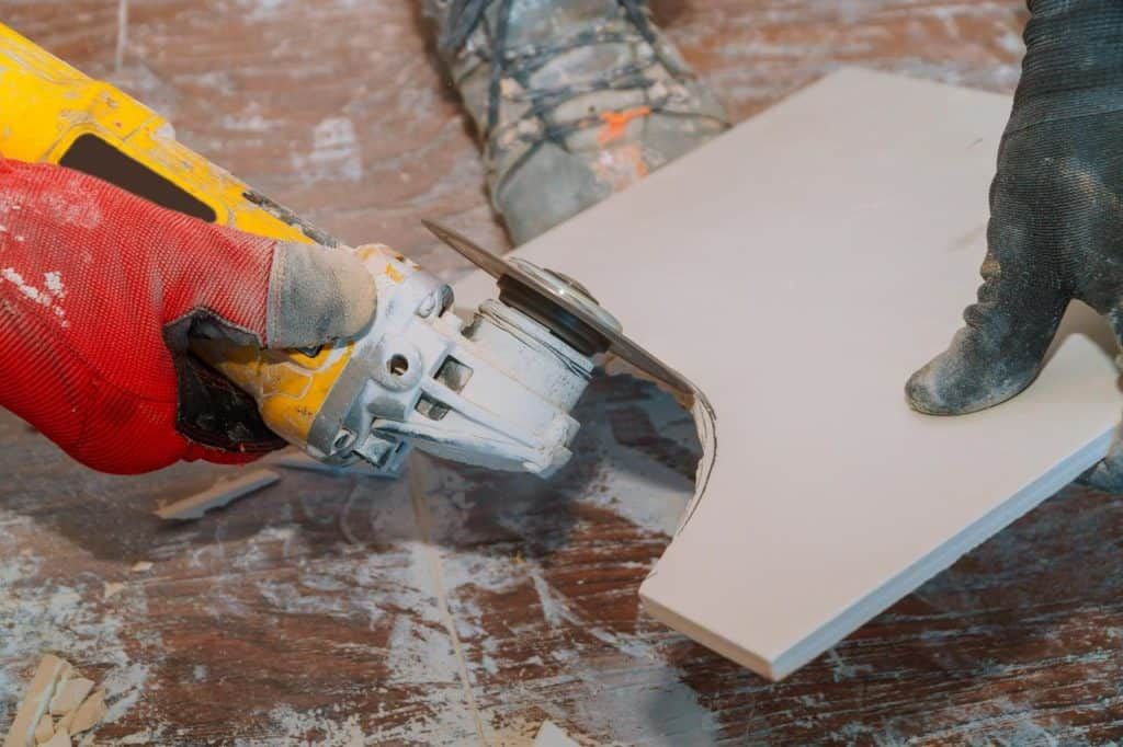 Angle grinder is used to cut tiles