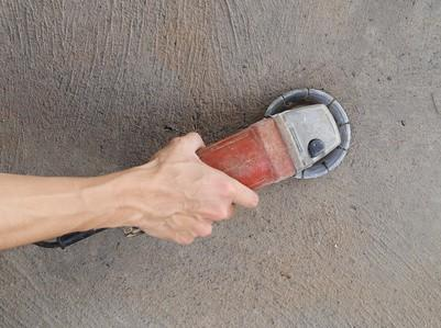 Grinding concrete with a concrete grinder