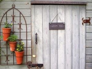 Garden shed with door and plants