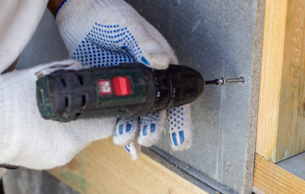 Screwing into concrete with a percussion hammer drill