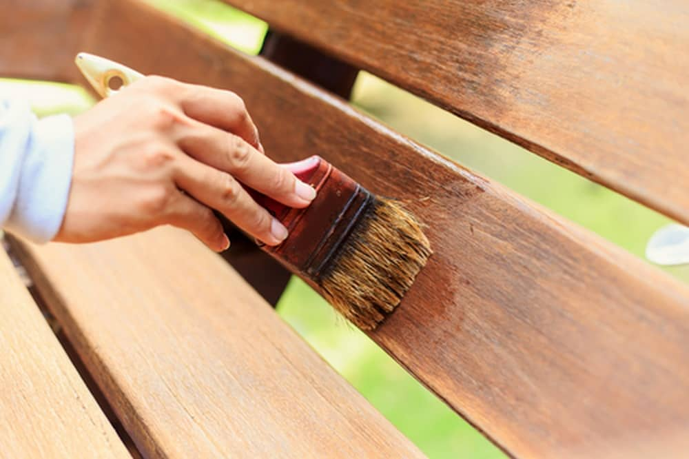 Applying Spar Urethane on a Bench