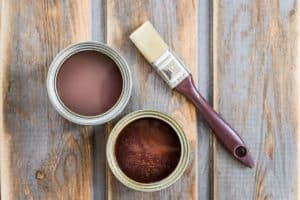 Cans of stain that is used as a wood colorant