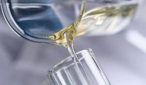 oil poured into a glass