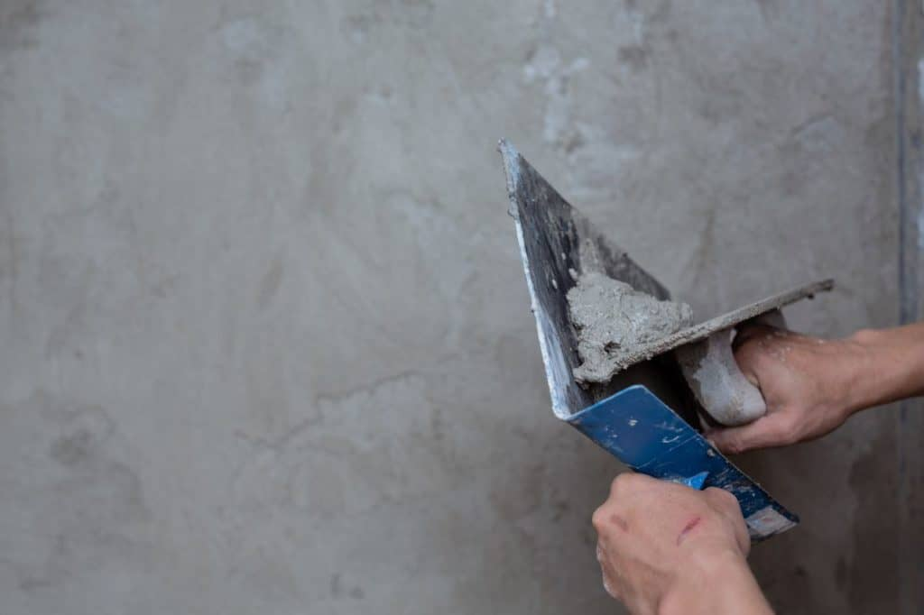 applying plaster on a wall