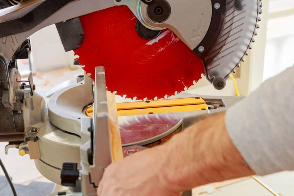 Sawing particle board with a miter saw